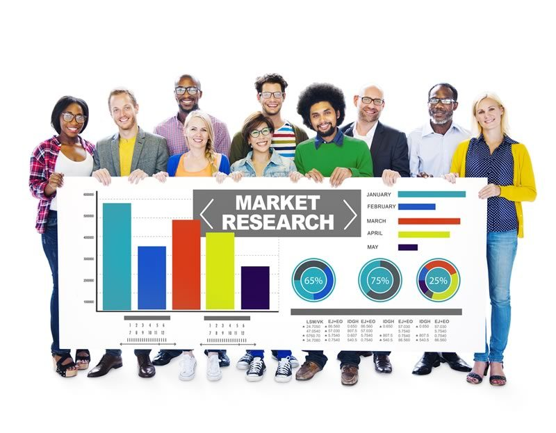 Group of people holding a market research report.