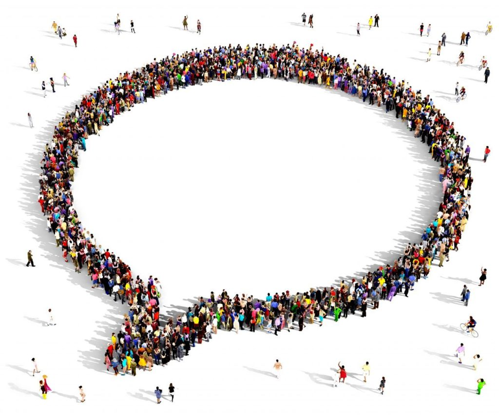 group of people in the shape of a speech bubble